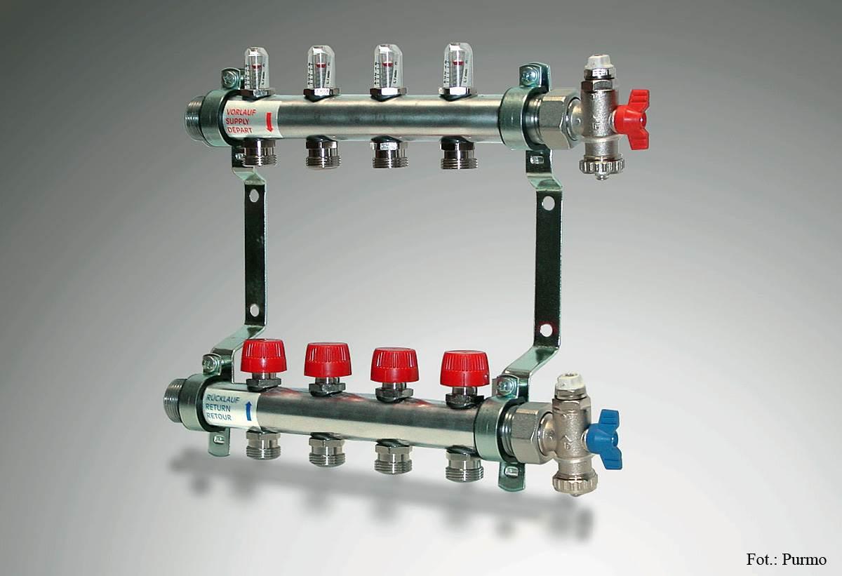 FOT. 5. Dokonując wyboru rozdzielacza oprócz materiału, z którego jest wykonany warto zwrócić uwagę na jego wyposażenie takie jak wkładki zaworowe przystosowane do montażu głowic termoelektrycznych z nastawami wstępnymi do regulacji hydraulicznej oraz wskaźnikami przepływu (rotametrami) ułatwiającymi poprawną regulację obiegów grzewczych.